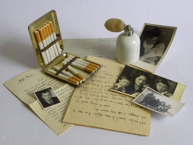 Perfume bottle and half empty cigarette case